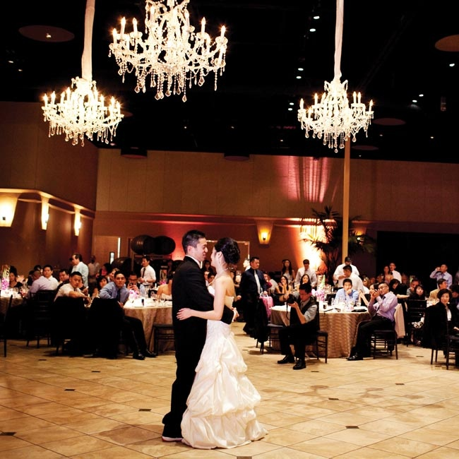 Chandeliers added mood lighting to the couple's first dance.