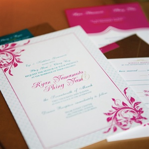 Magenta, teal and gold decorated the romantic yet modern invites.