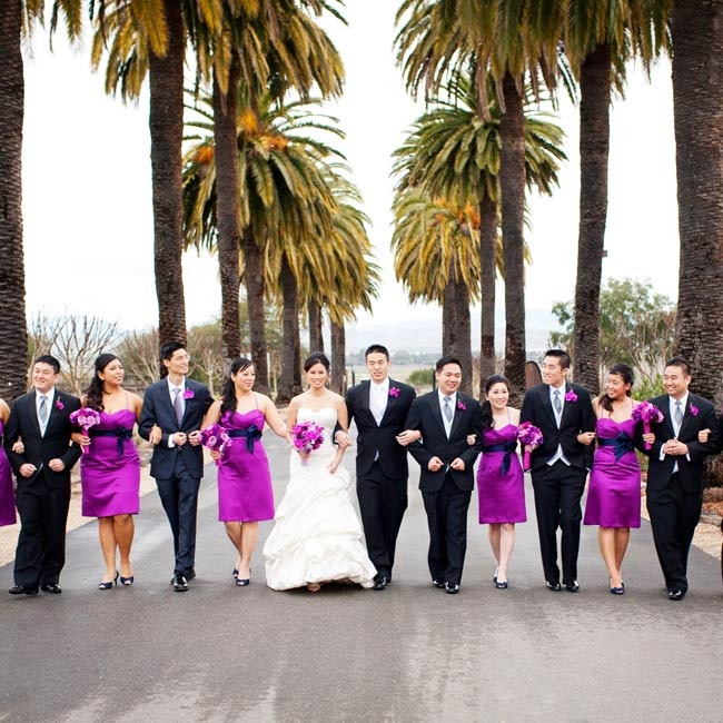 The girls matched the day's colors perfectly in magenta dresses, while the guys went with classic black tuxes.