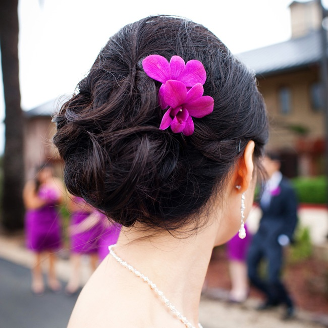 Phing accented her soft, curled updo with a single orchid.