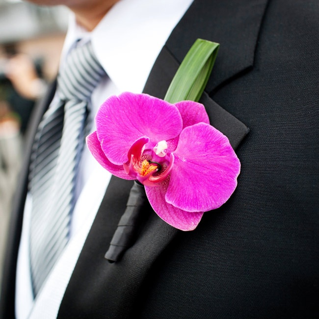 The guys wore fuchsia orchids on their lapels.