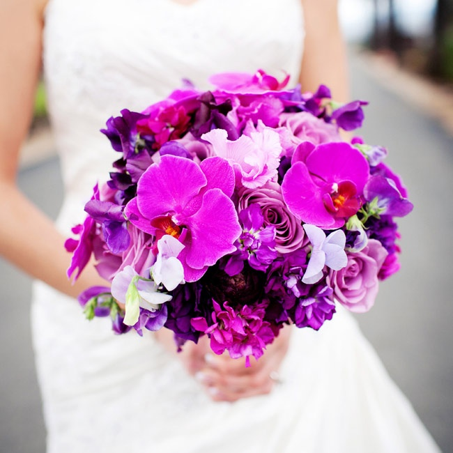 For her bouquet, Phing carried a lush, exotic bunch of purple orchids, roses and raspberry ranunculus.