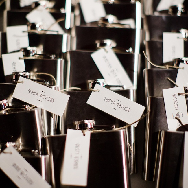 "Erika and Donald gave out flasks engraved with our name and wedding date on them. The flasks tied in with the 1920's theme, reminiscent of the prohibition. A ""speak easy"" was constructed specifically to hand out the party favors."