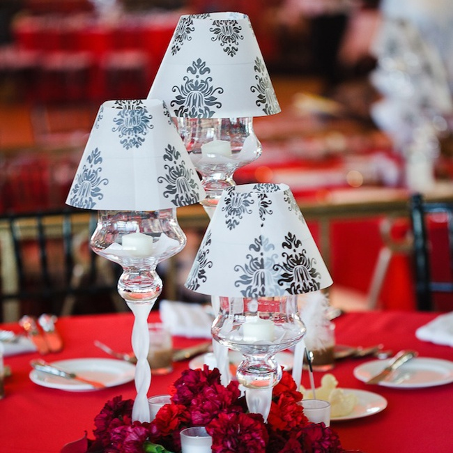 Keeping the image of the historic cotton club in mind, the variable height candelabras centerpieces were kept simple with patterned black and white lampshades.