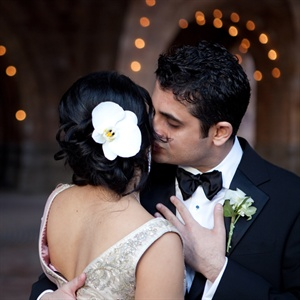 "Bindu wore my hair half up for the ceremony and added an orchid for the reception. She was going for ""a romantic look with soft waves."""