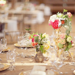 The reception dinner was served family style so the centerpieces were kept small in order to facilitate conversation between guests at the table.