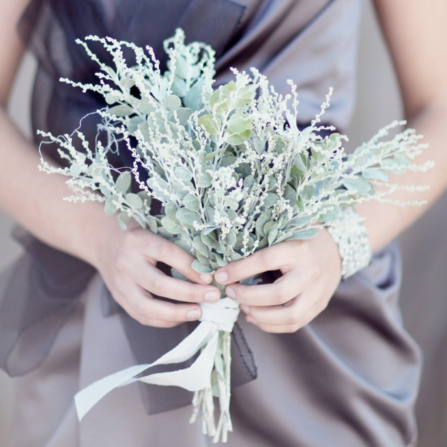 Each bridesmaid carried a different herb filled bouquet.