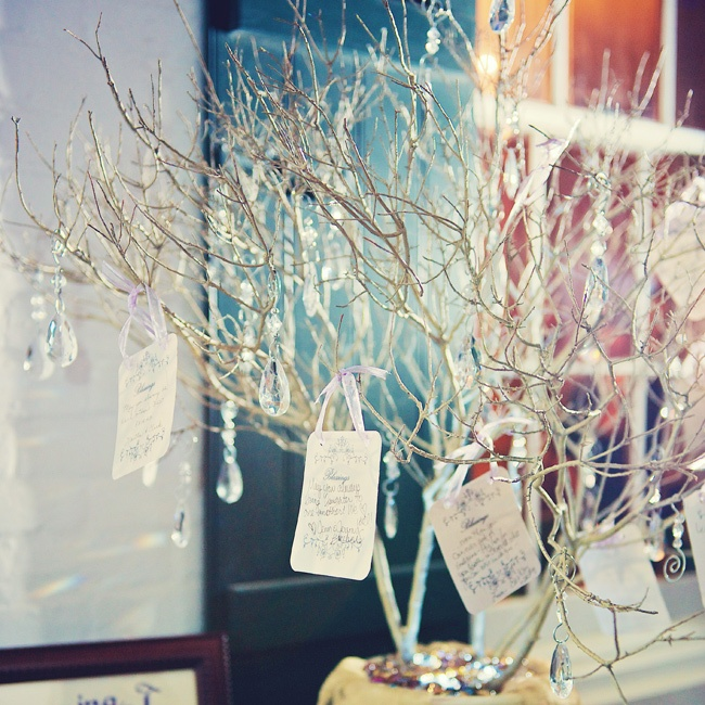 Guests hung a hand written blessing on a tree for the couple. Leigh and Jake also wrote out blessings for their guests to take home printed on lacy bookmarks, which reflected their love for literature.