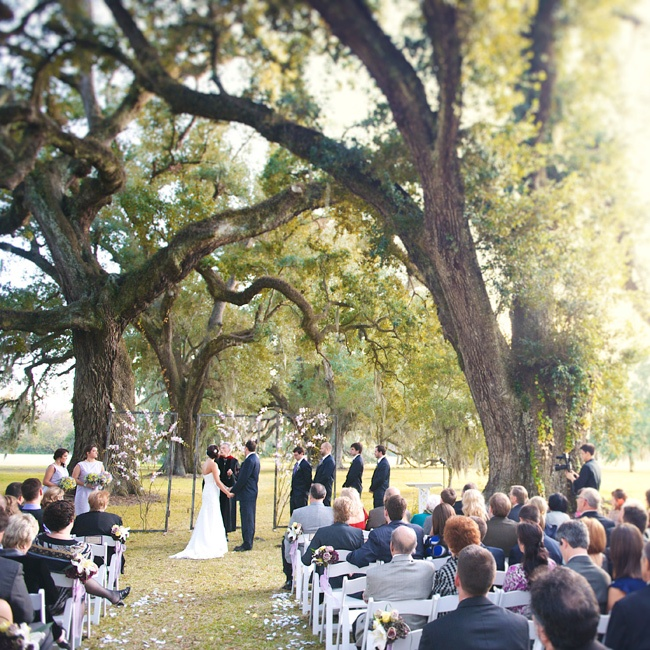 The ceremony was held under the canopy of two rows of the largest oak trees in Louisiana during sunset.