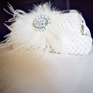 Leigh carried a small birdcage covered clutch adorned with a feathered vintage broach that matched her jewelry.