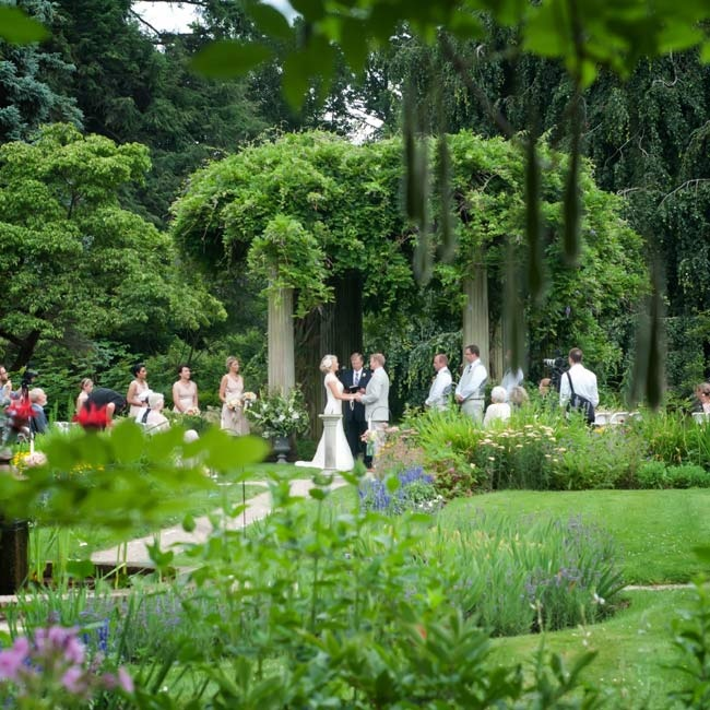 Helen and Matt exchanged vows in the garden under a wisteria-draped pergola.