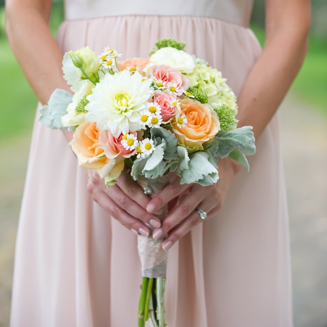 The girls carried smaller versions of Helen's bouquet. Feverfew and pastel roses added a punch of color.