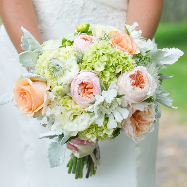 Soft blooms like David Austin roses, peonies, dusty miller and dahlias gave the bouquet a romantic look.