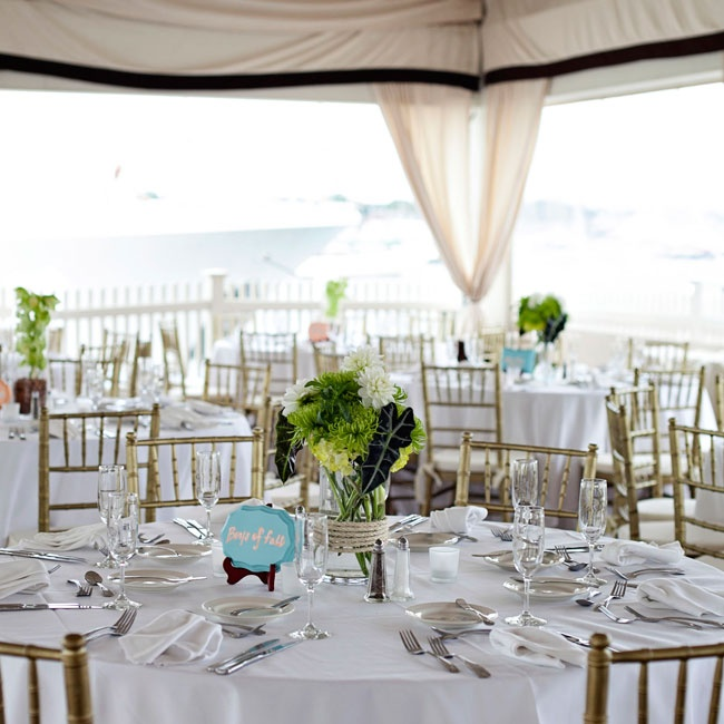 Nicki and Jeff wanted the natural elegance of the location to really stand out so they opted to keep the décor simple and elegant. One of the three centerpieces at the reception was a clear glass cylinder vase with nautical roping filled with white dahlias and green spider mums.