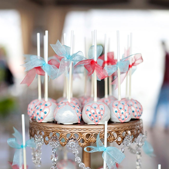 "Nicki and Jeff used their wedding colors throughout their entire wedding including the cake pops. Nicki felt ""the colors really signified the natural elements of earth and sky, balance of hot and"