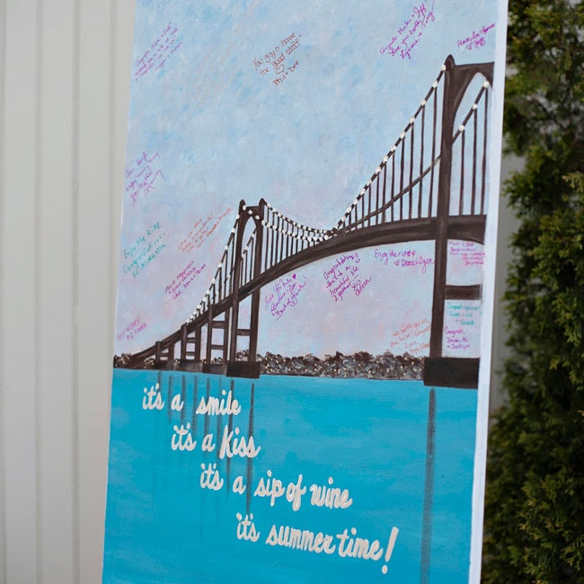 The sign-in board was a canvas painting of the Newport Bridge done by a friend of the bride and groom, Deb Snyder.