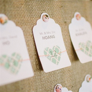 Nina made the peach-and-green escort cards herself.