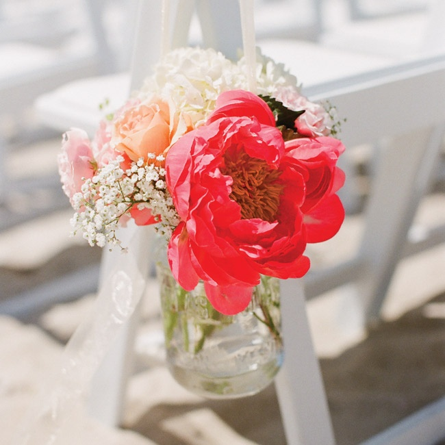 Small, bright bouquets hung from the ceremony seats.