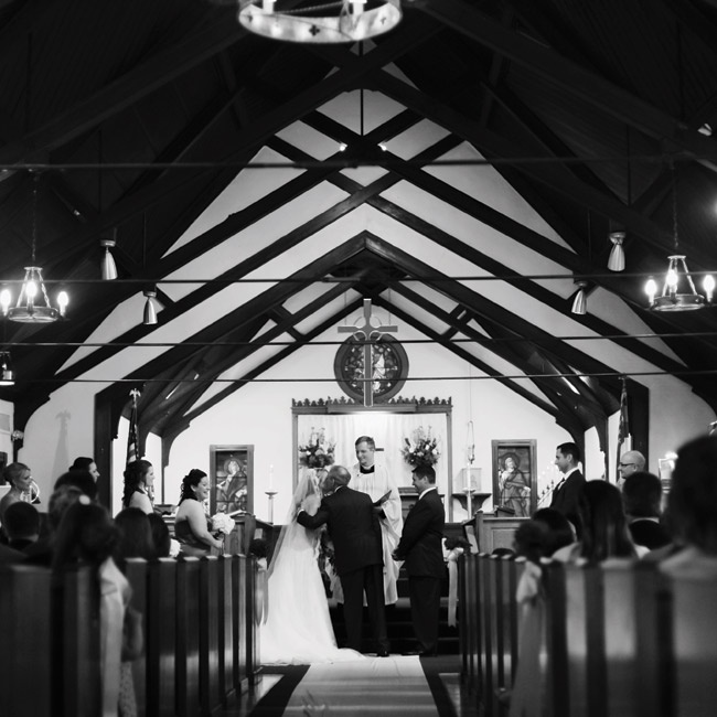 The couple wed in Emily's childhood church during an afternoon ceremony.