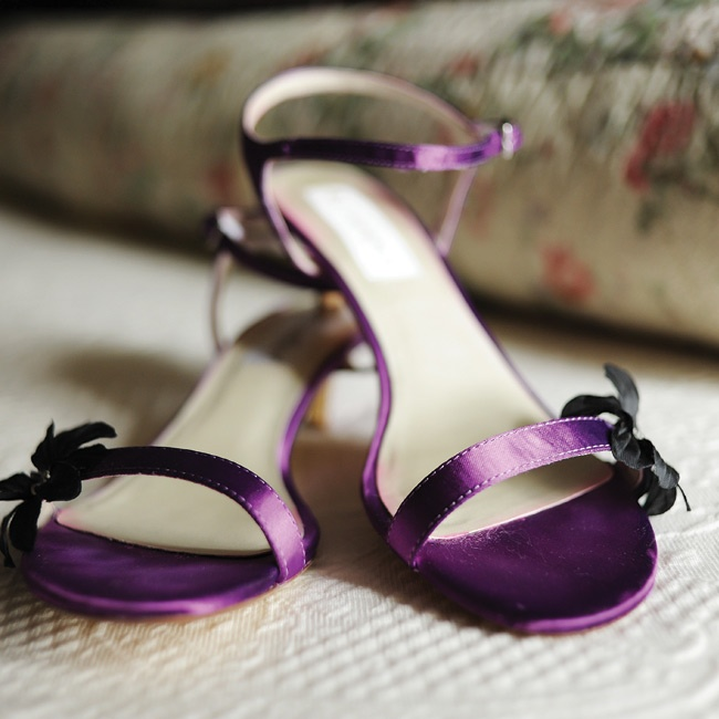 To match the bridesmaid dresses, Emily dyed her strappy sandals the same rich purple hue.