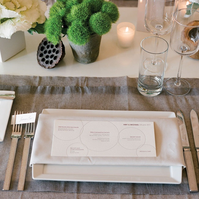 Modern place settings featured simple flatware and rectangular menu cards.
