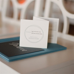 The trifold programs had a letterpress-printed gray font with a circle motif that tied all the wedding paper together.