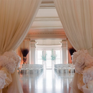 The afternoon ceremony was held in a long hallway at the mansion - Amy and Michael loved how bright it was and accentuated the décor with draping and sleek chairs.