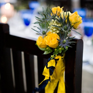 Yellow and blue flowers and ribbons decorated the couple's reception chairs.