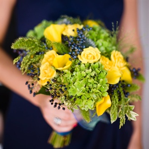 Each bridesmaid carried a unique bouquet of local flowers, like roses and calla lilies, and various greens.