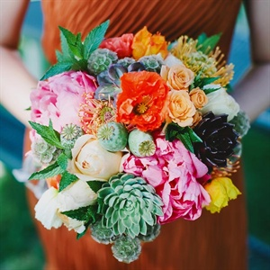 Diane's lush bouquet had succulents, roses, peonies, scabiosa pods and greens.