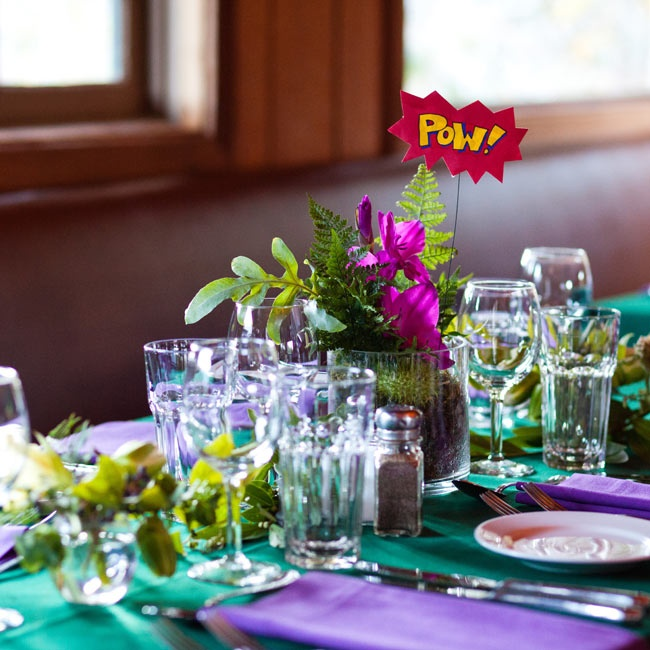 Matching the rest of the day's look, tables were topped with lush greens. The table numbers were speech action bubbles from comic books.