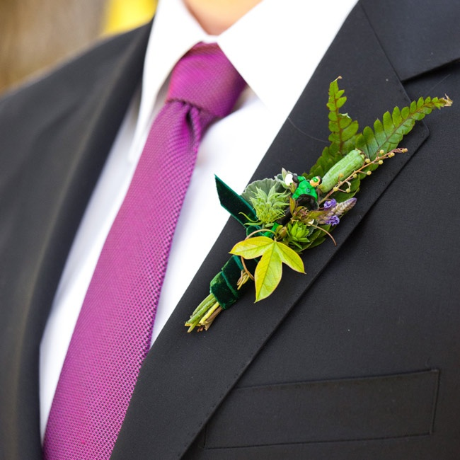 The guys wore leafy boutonnieres with mini action figures tucked in!