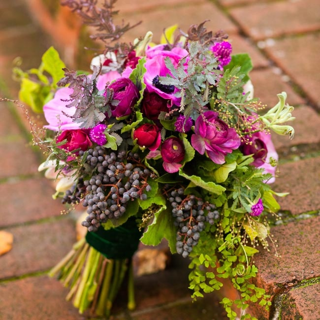 Miriam held an Ivy-inspired bunch of privet berries, purple flowers and greenery.
