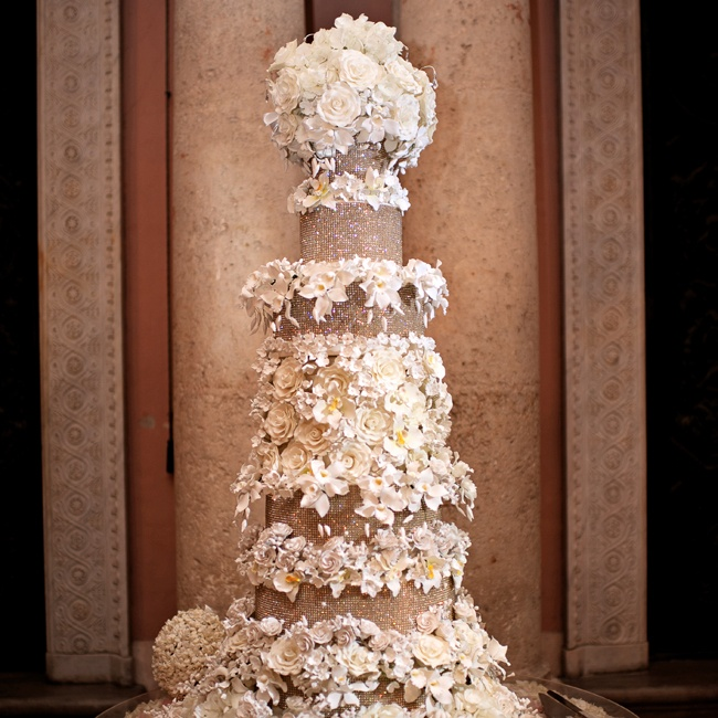 Over six feet tall, this eight-tiered cake is covered in handmade sugar flowers (which took more than a month to make), including hydrangeas, orchids, roses and stephanotis, and embellished with Swarovski crystals. This masterpiece took an entire staff three whole days to assemble.