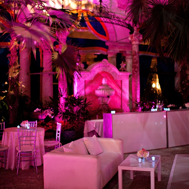 Take a pink color palette to the next level for the after-party to completely change the atmosphere. Here, hot-pink lighting, patterned gobos, Lucite bars and lounge furniture encouraged guests to stay on for a chic late-night party, where the music switched from a wedding band to a DJ for a total transformation.