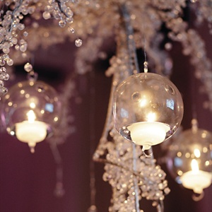 Glass bulbs hung from some reception centerpieces.