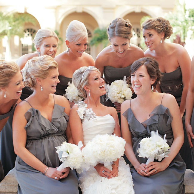 Six bridesmaids wore gray strapless dresses, while two others chose ruffled chiffon dresses in the same palette.