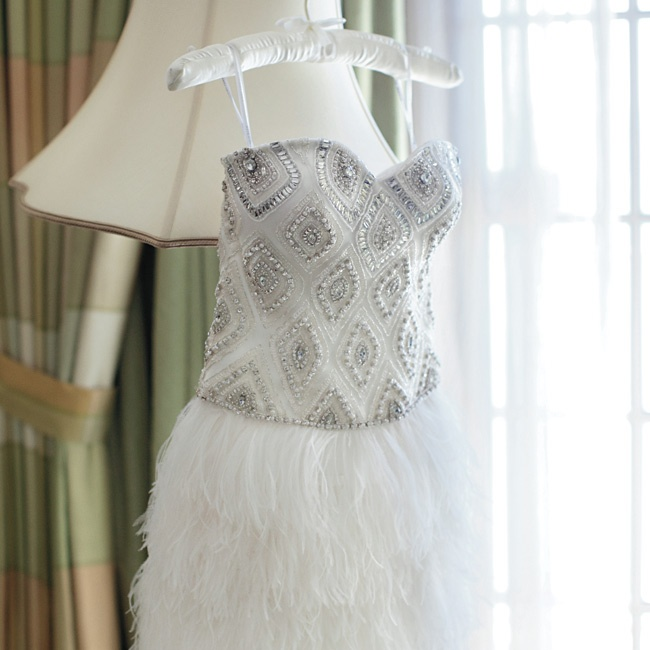 Lauren switched it up for dancing by changing into this flirty, feathery bejeweled number.