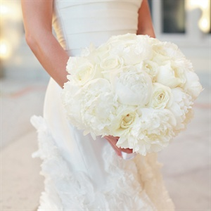 Lauren carried a lush all-white bouquet of peonies.