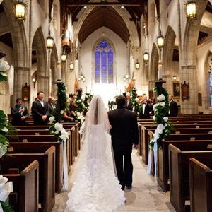 The aisle stands were decorated with garlands of white flowers and various greenery.