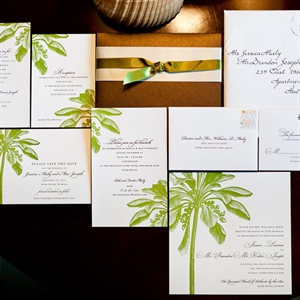 Green letterpress palm trees decorated the invitations.