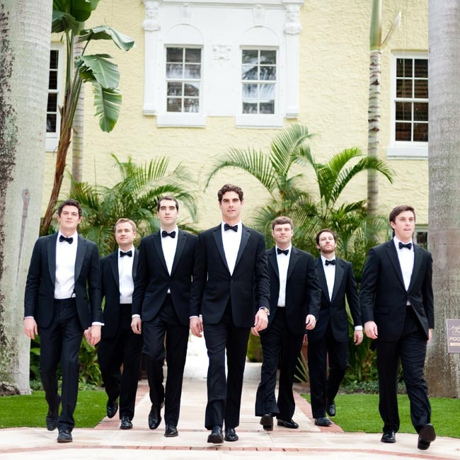 The guys matched in classic black tuxedos with bow ties.