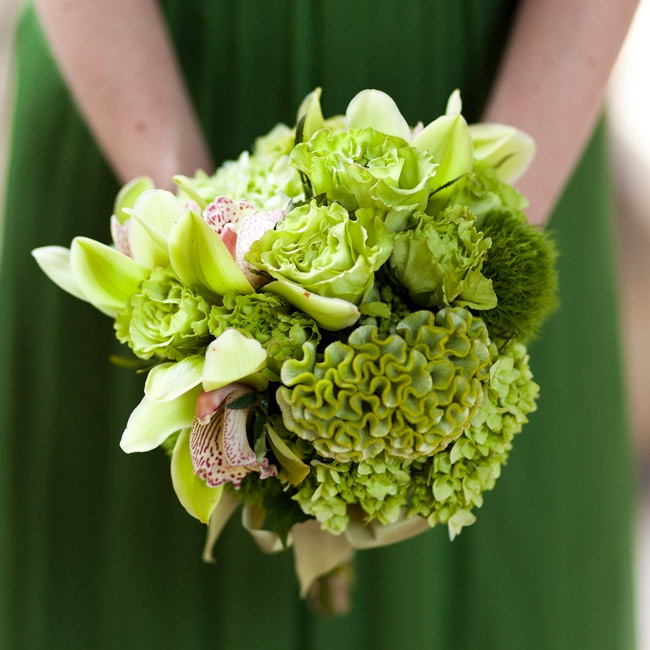 The girls carried green bunches of orchids and hydrangeas.