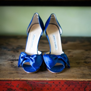 "For her ""something blue,"" Jessica wore royal-blue heels with a bow embellishment."