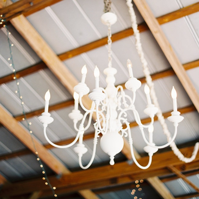 White chandeliers hung from the ceiling at the reception.