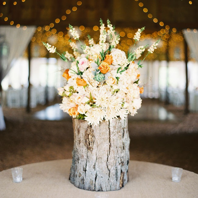 This textured arrangement of ivory and orange flowers sat at the entrance to the reception space.