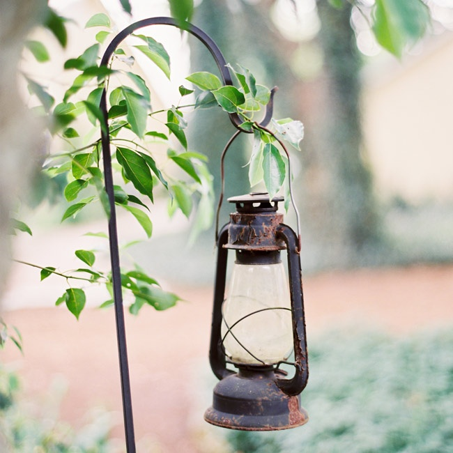 Lanterns hung from shepherd's hooks for a vintage touch.