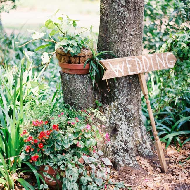 Handmade wooden signs directed guests to the wedding location.