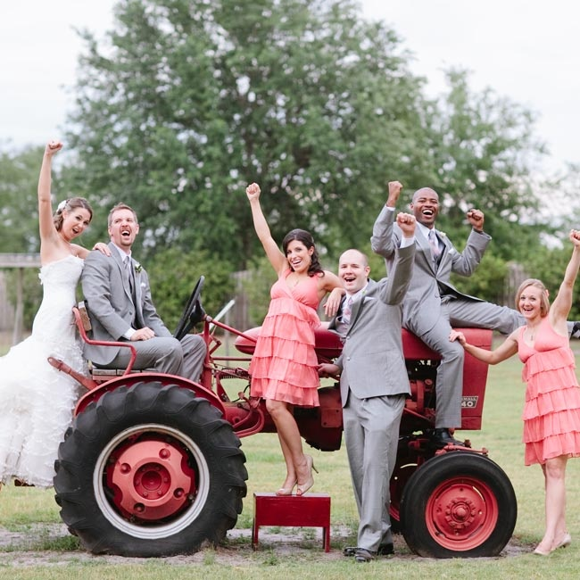 The bridesmaids wore coral ruffled dresses, while the guys donned gray suits.