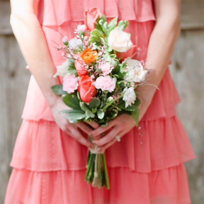 The bridesmaids carried small bouquets of roses, ranunculus, carnations and curly willow branches.